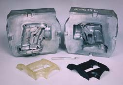cast kirksite mold with injection molded parts